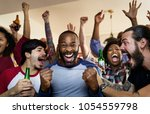 frieds cheering sport at bar... | Shutterstock . vector #1054559798