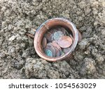 ancient jug with coins. old... | Shutterstock . vector #1054563029