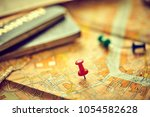 pins marking travel itinerary... | Shutterstock . vector #1054582628
