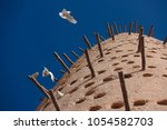 pigeon towers  traditional... | Shutterstock . vector #1054582703