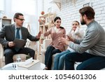 adult male with woman quarrels... | Shutterstock . vector #1054601306