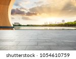 empty square floor and modern... | Shutterstock . vector #1054610759