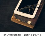 part old book tablet and... | Shutterstock . vector #1054614746