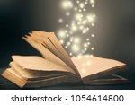 old book open light  effect... | Shutterstock . vector #1054614800