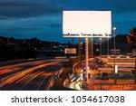 blank billboard at twilight...   Shutterstock . vector #1054617038