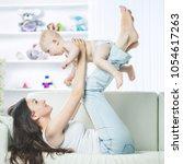 concept of motherhood happy... | Shutterstock . vector #1054617263