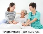 asian senior woman sick in...   Shutterstock . vector #1054619738