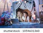 grandmother and granddaughter... | Shutterstock . vector #1054631360