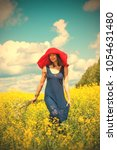 a woman in a red hat and a... | Shutterstock . vector #1054631480