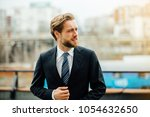 portrait of smiling handsome...   Shutterstock . vector #1054632650