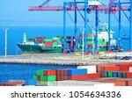 port cargo crane  ship and... | Shutterstock . vector #1054634336