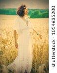 beautiful woman in a white... | Shutterstock . vector #1054635200