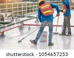 construction worker coating...   Shutterstock . vector #1054657253