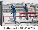 construction worker coating...   Shutterstock . vector #1054657256