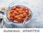 spaghetti pasta with meatballs... | Shutterstock . vector #1054657910