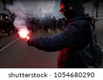 police uses a water canon... | Shutterstock . vector #1054680290