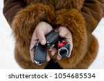 ignition keys in hands | Shutterstock . vector #1054685534