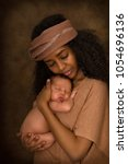 ethiopian young mother holding... | Shutterstock . vector #1054696136
