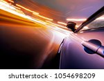 car on the road with motion... | Shutterstock . vector #1054698209
