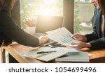 executive office employees are... | Shutterstock . vector #1054699496