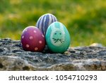 painted easter egg showng... | Shutterstock . vector #1054710293
