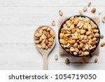 roasted peanuts are put in a... | Shutterstock . vector #1054719050
