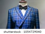 luxury suit in store | Shutterstock . vector #1054729040