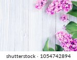 lilac flowers on wooden table... | Shutterstock . vector #1054742894