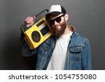 hipster man listening to... | Shutterstock . vector #1054755080