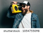 hipster man listening to... | Shutterstock . vector #1054755098