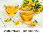 two cups of hypericum herbal ... | Shutterstock . vector #1054800953