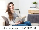 portrait of smiling woman... | Shutterstock . vector #1054806158