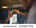 group of friends having drinks... | Shutterstock . vector #1054807598