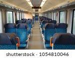 interior of a passenger train... | Shutterstock . vector #1054810046