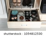 stylish accessories in drawer... | Shutterstock . vector #1054812530