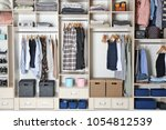 large wardrobe closet with... | Shutterstock . vector #1054812539