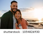 man holding his partner with... | Shutterstock . vector #1054826930