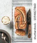 Small photo of Butter-free, sugar-free banana bread with oat flour, soft curd cheese and honey. Top view of sliced banana bread on gray cement background. Ideas and recipes for healthy diet breakfast. Vertical.