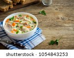 chicken and wild rice soup.... | Shutterstock . vector #1054843253