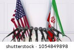 flags of the usa and iran at... | Shutterstock . vector #1054849898
