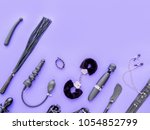 Stock photo various sex toys fur hancuffs vibrator leather whip dildo spanking paddle and other are on a 1054852799