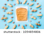 bread toast with walnut paste... | Shutterstock . vector #1054854806