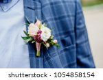 groom in a jacket. the morning... | Shutterstock . vector #1054858154