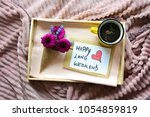 breakfast on a tray in bed with ...   Shutterstock . vector #1054859819