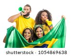 Small photo of Brazil supporters. Brazilian group of fans celebrating on soccer / football match on white background. Brazil colors. Person is blowing a horn. Flag.