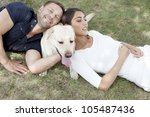 Stock photo young couple sitting with dog 105487436