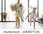 funny happy kids running into... | Shutterstock . vector #1054877126