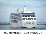 cruise tourist ship mooring in... | Shutterstock . vector #1054900124