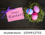 happy easter card with three... | Shutterstock . vector #1054913753