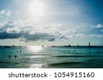 Small photo of Sunny dag on Boracay beach. People och boats in the water.